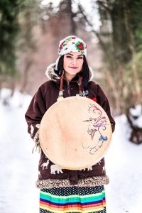 Indigenous storyteller with drum